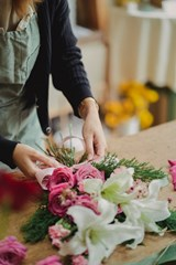 Florist_Creating_Mothers_Day_Bouquet_of_Lilies_and_Roses